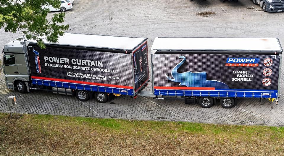 Schmitz Cargobull: грузовик и прицеп с кузовами MEGA